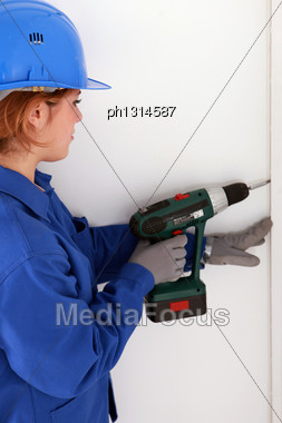 Woman Using Drill Stock Photo