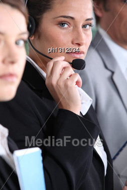 Woman Using Headset Stock Photo