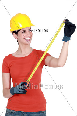 Woman Using Tape Measure Stock Photo