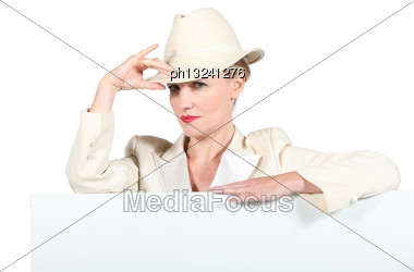 Woman Wearing Creme Coloured Hat And Jacket Stood With Message Board Stock Photo