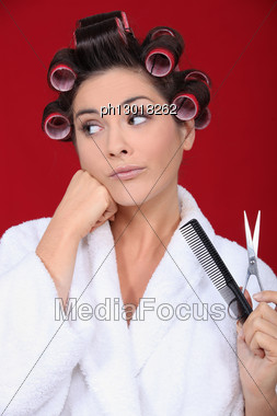 Woman Wearing Hair Rollers Stock Photo
