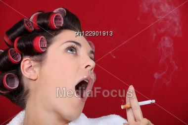 Woman Wearing Hair-rollers Smoking Stock Photo