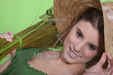 Woman Wearing Straw Hat Stock Photo