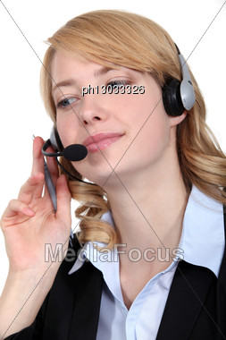 Woman Wearing Telephone Head-set Stock Photo