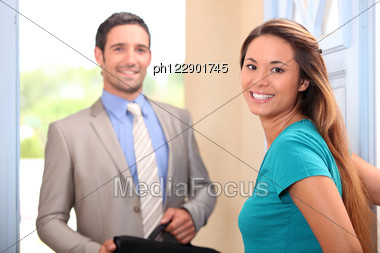 Woman Welcoming Her Husband Home Stock Photo