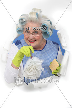 Woman With A Feather Duster Stock Photo