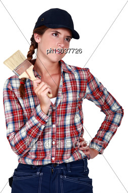 Woman With A Paintbrush Stock Photo