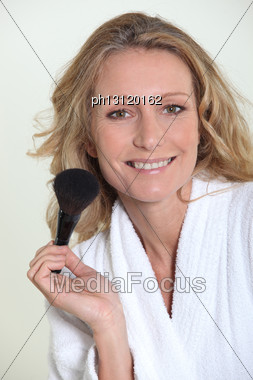 Woman With Blusher Brush Stock Photo
