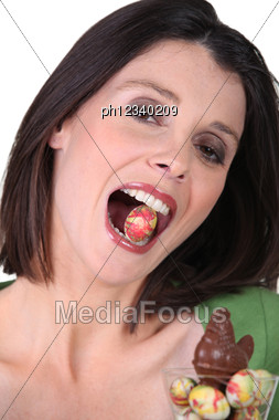 Woman With An Easter Egg In The Mouth Stock Photo