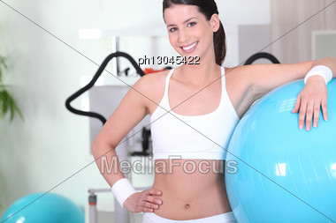 Woman With An Exercise Ball In A Gym Stock Photo