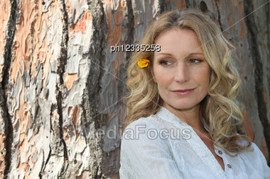 Woman With Flower In Hair Stock Photo
