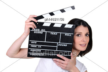 Woman With Movie Slate Stock Photo
