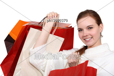 Woman With Plenty Of Shopping Bags. Stock Photo