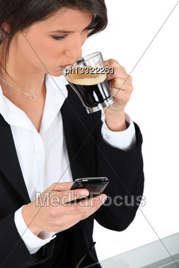 Woman With Telephone And Coffee Stock Photo