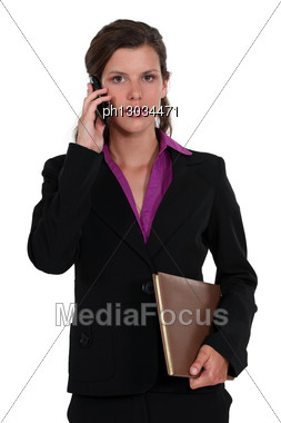 Woman With The Phone And Folder Stock Photo