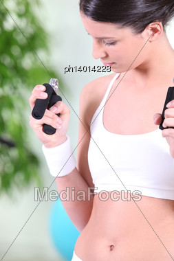Woman Working Out At The Gym Stock Photo