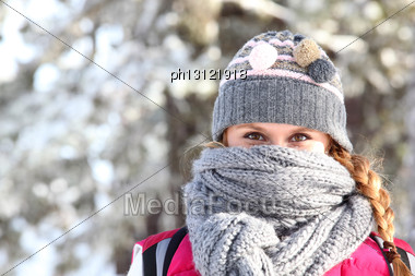 Women Covering Her Face With Scarf To Keep Warm Stock Photo