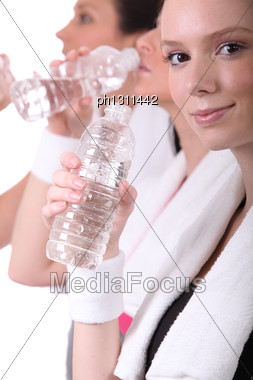 Women Drinking Water After Training Stock Photo