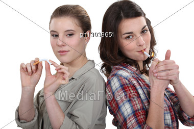Women For And Against Smoking Stock Photo