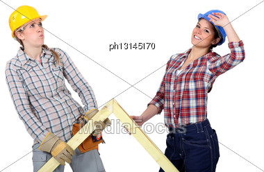Women Lifting Wooden Triangle Stock Photo