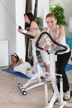 Women Using Stepper Machine Stock Photo