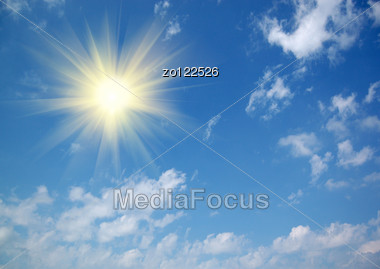 Wonderful Clouds And Sun Against Blue Sky Stock Photo
