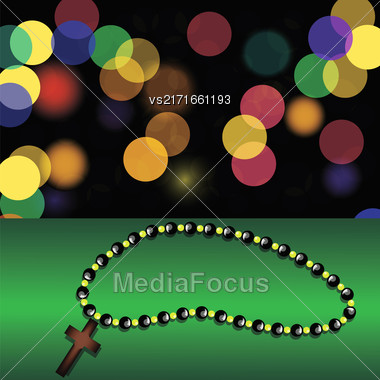 Wood Cross On Green Table. Blurred Colorful Lights Background. Wooden Religious Cross And Rosary Stock Photo