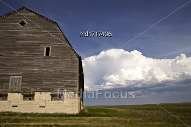 Wooden Barn Canada And Storm Clouds Thunderhead Stock Photo