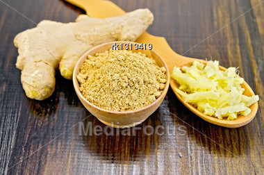 Wooden Bowl With Powder And A Wooden Spoon With Grated Ginger, Ginger Root On The Background Of Wooden Board Stock Photo
