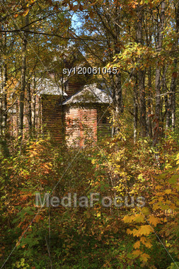 Wooden Chapel In Autumn Wood Stock Photo