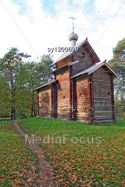 Wooden Chapel In Autumn Wood Stock Photo