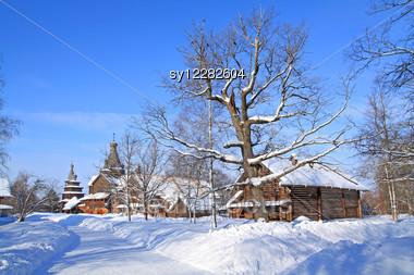 Wooden Chapel In Winter Village Stock Photo