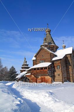 Wooden Chapel On Snow Field Stock Photo