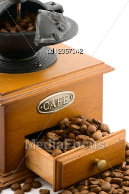 Wooden Coffee Grinder With Beans On White Stock Photo