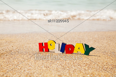 Wooden Colorful Word 'Holiday' On The Sand Stock Photo