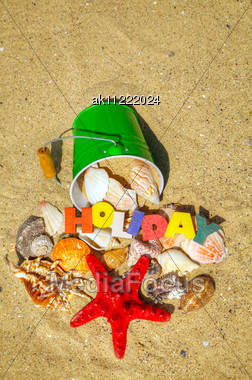Wooden Colorful Word 'Holiday' With Shells On The Sand Stock Photo