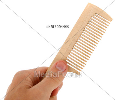 Wooden Comb In The Hand Stock Photo