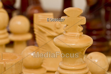 Wooden figures on a chess board Stock Photo