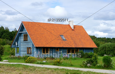 Wooden House On A Background Of The Cloudy Sky Stock Photo