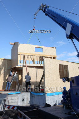 Wooden House Frame Being Built Stock Photo