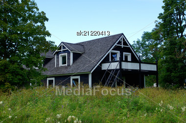 Wooden House On A Background Of The Sky Stock Photo