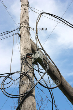 Wooden Pole With Wires Stock Photo