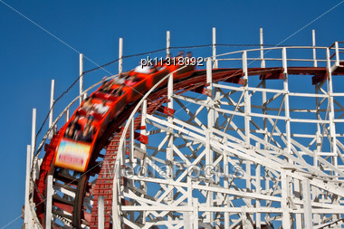 Wooden Rollercoaster With People (blurred Motion Stock Photo