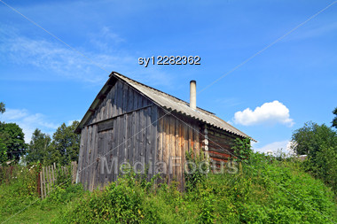 Wooden Rural House Amongst Herbs Stock Photo