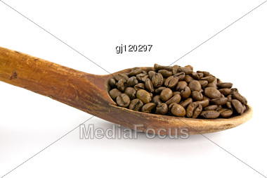 Wooden Spoon With Coffee Beans Stock Photo