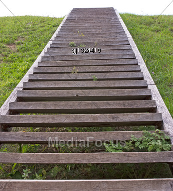 Wooden Stairs Climbing To The Summit Of The Hill Stock Photo