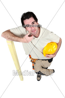 Woodworker Leaning On A Board Stock Photo