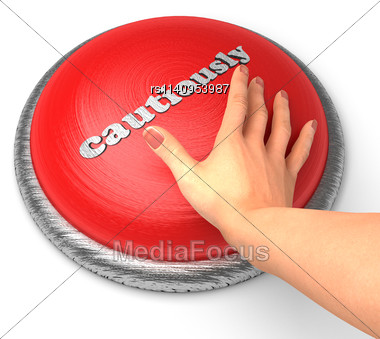 Word Cautiously On Button With Hand Pushing Stock Photo