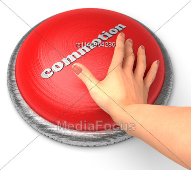 Word Commotion On Button With Hand Pushing Stock Photo