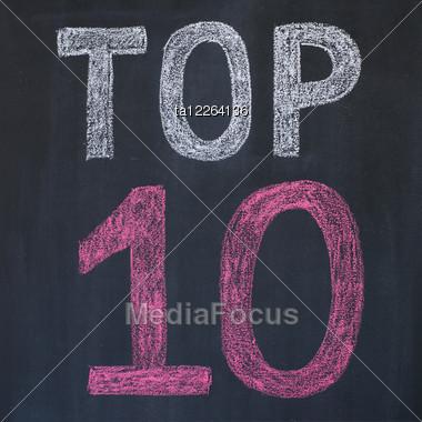 """Word """"Top 10'' Written By A Chalk On A Blackboard Stock Photo"""